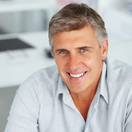 Middle-age man smiling while wearing a shirt
